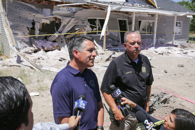 Nevada Governor Brian Sandoval, left, speaks to the media and community members with Lincoln County Sheriff Kerry Lee on Friday, July 15, 2016, at the attacked house in Panaca, Nev., about the Wed ...