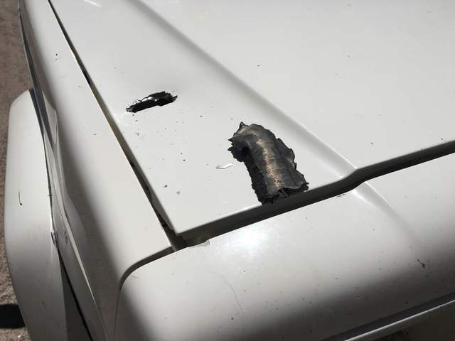Shrapnel from an explosion tore into Myron Buescher's truck Wednesday night, July 13, 2016, in his Panaca neighborhood. (Kimber Laux/Las Vegas Review-Journal)
