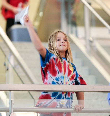 Team TSA member Nevaeh Letterman, 7, throws her paper plane in the distance contest during the fourth annual Paper Plane Palooza event at McCarran International Airport on Wednesday, Aug. 10, 2016 ...