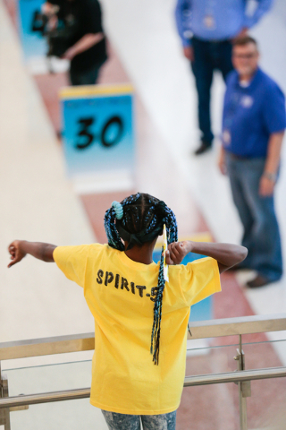 Team Spirit member Ariana McCraney, 11, prepares to throw her plane in the distance contest during the fourth annual Paper Plane Palooza event at McCarran International Airport on Wednesday, Aug.  ...