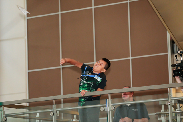 Team United member Jose Ruiz-Magaa, 9, throws his airplane in the  distance finals during the fourth annual Paper Plane Palooza event at McCarran International Airport onWednesday, Aug. 10, 2016.  ...
