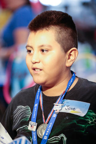 Team United member Jose Ruiz-Magaa, 9, talks with a reporter after winning the distance contest, at the Paper Plane Palooza event at McCarran International Airport on Wednesday, Aug. 10, 2016. Chi ...