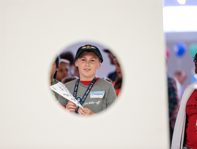 Team Alaska member Christian Whitbread, 13, prepares to throw his paper plane through the accuracy target at the Paper Plane Palooza event at McCarran International Airport on Wednesday, Aug. 10,  ...