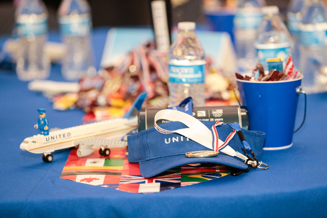 Swag items are shown at the team United table prior to the start of the fourth annual Paper Plane Palooza event held at McCarran International Airport on Wednesday, Aug. 10, 2016. Children from lo ...