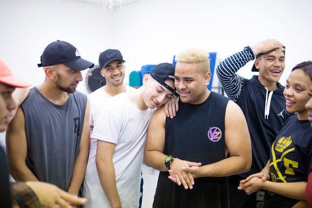 Dancers in the New Zealand dance crew, The Royal Family created by Parris Goebel, an award-winning New Zealand-born choreographer, dancer, and now singer, take a break during practice at Backstage ...