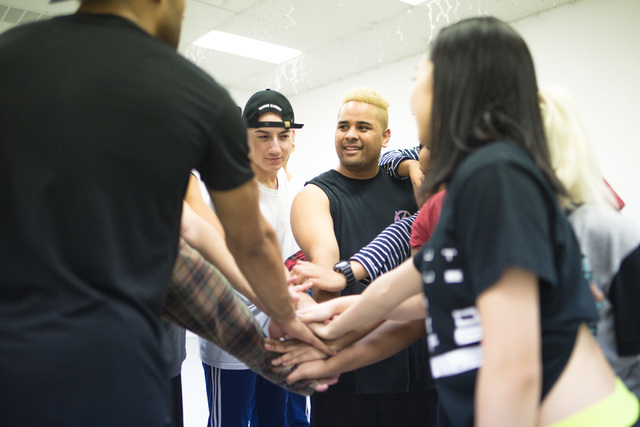 Dancers in the New Zealand dance crew, The Royal Family, created by Parris Goebel, an award-winning New Zealand-born choreographer, dancer, and now singer, put their hands together before taking a ...