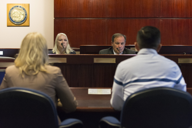 Nevada Treasurer Dan Schwartz, right, and Nevada Deputy Treasurer Sheila Salehian listen as A.J. Buhay, with Progressive Leadership Alliance of Nevada, and Tennille Pereira, with Legal Aid Center  ...