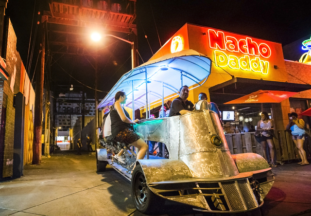 Ben Contorno, a driver for the Vegas Pub Crawler bicycle tour, takes passengers from Nacho Daddy to the Downtown Container Park on Thursday, August 18, 2016, in Las Vegas. (Benjamin Hager/Las Vega ...