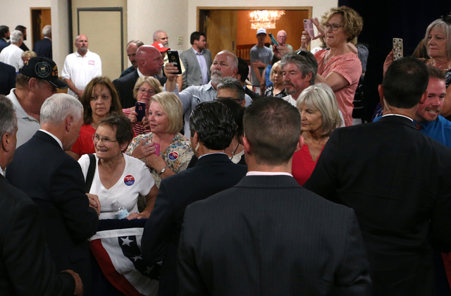 Republican vice presidential candidate Gov. Mike Pence, R-Ind., talks with members of the crowd following a rally in Carson City, Nev., on Monday, Aug. 1, 2016. Cathleen Allison/Las Vegas Review J ...