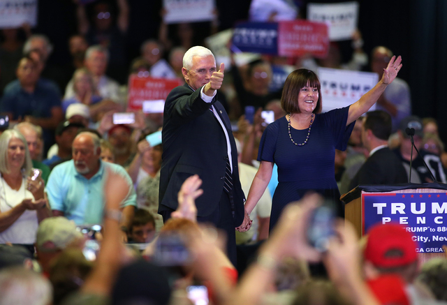 Republican vice presidential candidate Gov. Mike Pence, R-Ind., and his wife Karen campaign in Carson City, Nev., on Monday, Aug. 1, 2016. Cathleen Allison/Las Vegas Review Journal