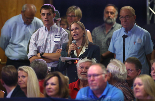 Catherine Byrne, whoճ son is in the Air Force, asks Republican vice presidential candidate Gov. Mike Pence, R-Ind., about Donald Trumpճ disrespect for  the military during a rally in C ...