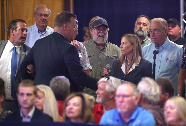 Catherine Byrne, center, whoճ son is in the Air Force, asks Republican vice presidential candidate Gov. Mike Pence, R-Ind., about Donald Trumpճ disrespect for the military during a ral ...