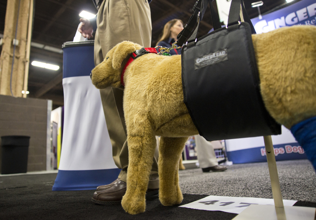 A Ginger Lead assistive device for dogs with weak hind legs sits on display during the SuperZoo Trade Show at the Mandalay Bay Convention Center on the Las Vegas Strip on Tuesday, Aug. 2, 2016. (D ...
