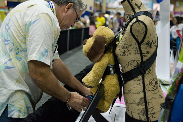 Dennis Presley stops to get information about a dog harness during the SuperZoo Trade Show at the Mandalay Bay Convention Center on the Las Vegas Strip on Tuesday, Aug. 2, 2016. (Daniel Clark/Las  ...