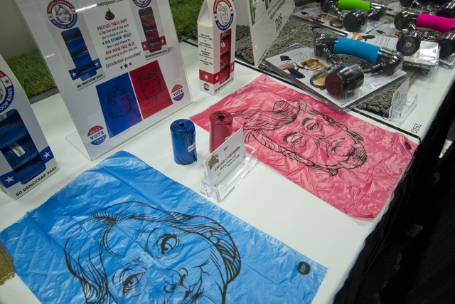 Pet waste bags featuring caricatured versions of presidential hopefuls sit on display during the SuperZoo Trade Show at the Mandalay Bay Convention Center on the Las Vegas Strip on Tuesday, Aug. 2 ...