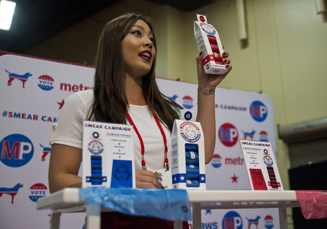 Ashley Wong shows off pet waste bags featuring caricatured versions of presidential hopefuls during the SuperZoo Trade Show at the Mandalay Bay Convention Center on the Las Vegas Strip on Tuesday, ...