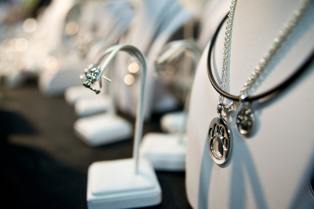 Pet themed jewelry sits on display during the SuperZoo Trade Show at the Mandalay Bay Convention Center on the Las Vegas Strip on Tuesday, Aug. 2, 2016. (Daniel Clark/Las Vegas Review-Journal) Fol ...