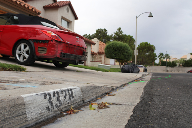 Paint from a police investigation marks the path of a car involved in fatal accident at 3328 Surfline Drive on Thursday, Aug. 4, 2016. (Brett Le Blanc/Las Vegas Review-Journal Follow @bleblancphoto)