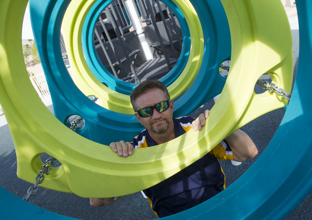 Raymond L. Everhart, park operations manager for the City of Henderson, poses on the Biba smart playground at Burkholder Park located at 645 W. Victory Road in Henderson on Thursday, Aug. 18, 2016 ...