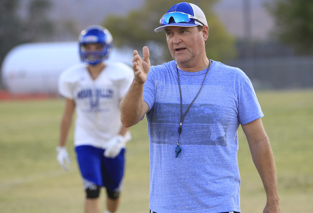 Moapa Valley High School football coach Brent Lewis instructs his team during team practice at the school in Overton, Nev. on Wednesday, Aug. 17, 2016. Richard Brian/Las Vegas Review-Journal Follo ...