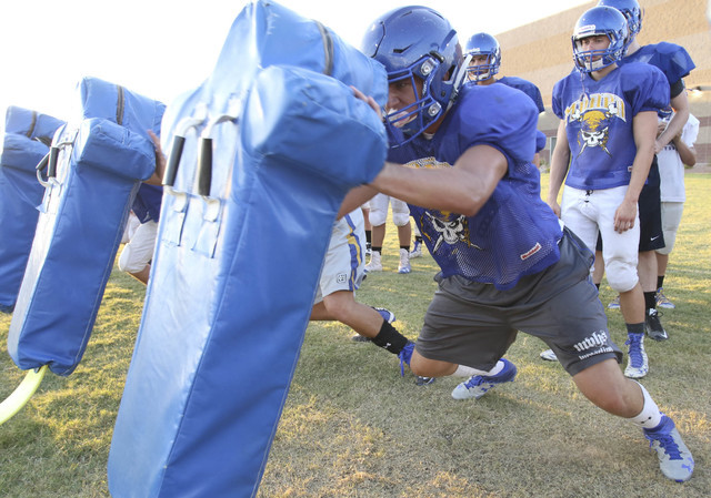 Moapa Valley High School center Cameron Larsen does a drill during team practice in at the school Overton, Nev. on Wednesday, Aug. 17, 2016. Richard Brian/Las Vegas Review-Journal Follow @vegaspho ...