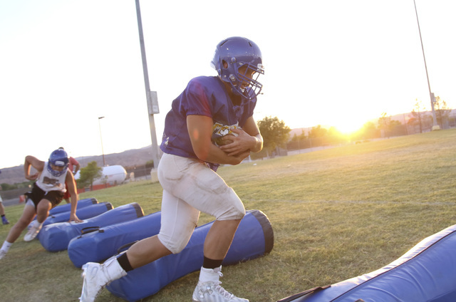 Moapa Valley High School fullback Dalyn Leavitt runs the ball on a drill during team practice at the school in Overton, Nev. on Wednesday, Aug. 17, 2016. Richard Brian/Las Vegas Review-Journal Fol ...