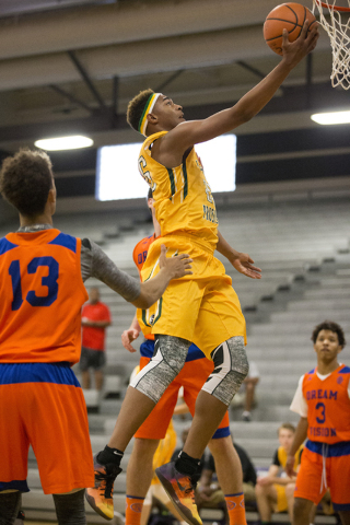 Las Vegas Prospects' Charles O'Bannon Jr. (25) goes up for a shot against Dream Vision in the NY2LA Sports Summer Showndown tournament game at Durango High School on Wednesday, July 20, 2016, in L ...