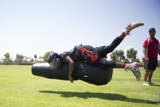 Tyrell Brooks, 16,  tackles a football dummy during a team practice at Mountain View Christian High School on Tuesday, Aug. 23, 2016, in Las Vegas. Erik Verduzco/Las Vegas Review-Journal Follow @E ...