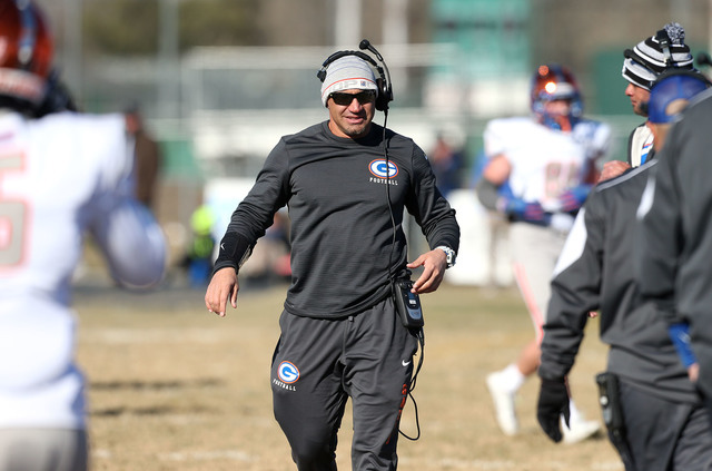 In this file photo Bishop Gorman Head Coach Kenny Sanchez works the sidelines of a playoff game against Reed High School in Sparks, Nev. Gorman defeated Cedar Hill (Texas) 44-14 Saturday night in  ...