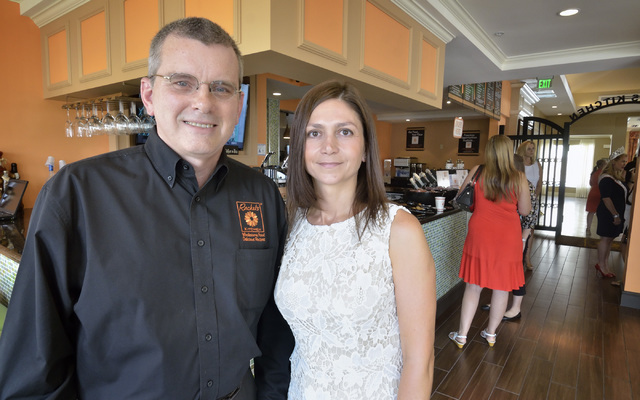 Debbie Roxarzade, founder and CEO of Rachel's Kitchen, right, is shown with franchisee John Henderson during the grand opening for the company's newest restaurant at the Hilton Garden Inn at 1 ...