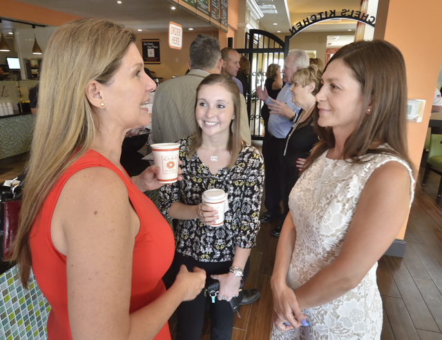 Debbie Roxarzade, founder and CEO of Rachel's Kitchen, right, talks with Laura Porreca, left and Rachel Frazer during a grand opening for the company's latest franchise at the Hilton Garden Inn at ...