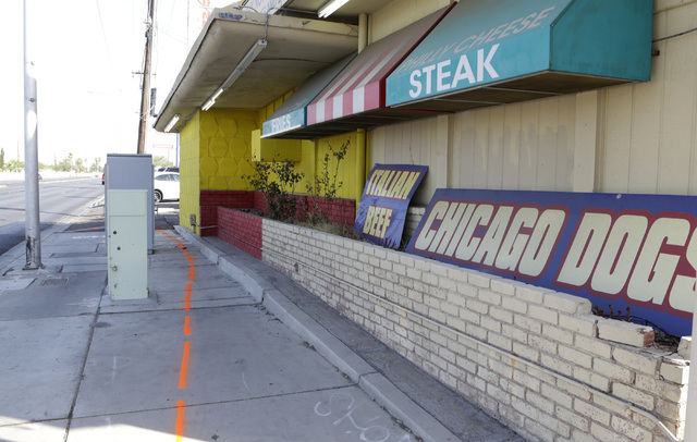 Orange paint marks the crash scene outside the Chicago Dogs building at 1078 N. Rancho Drive on Wednesday, Aug. 10, 2016. A Las Vegas man died after his motorized scooter crashed into the business ...