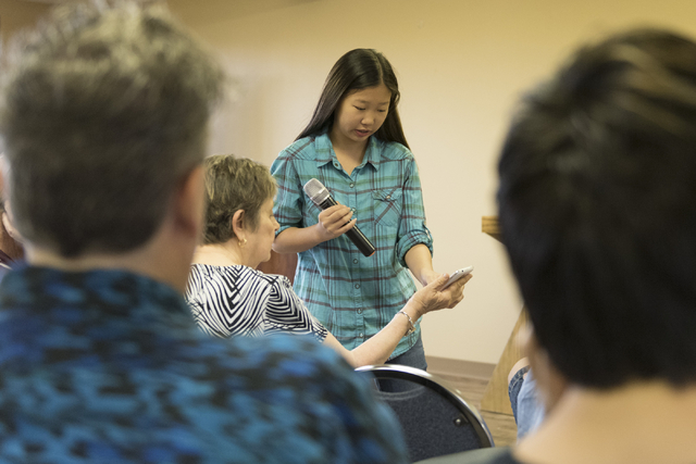Alex Morgan, 16, center, gives instruction to Judy Hoffman, 73, as she volunteers by teaching a smartphone usage class at Indigo Valley Church in Las Vegas on Friday, Aug. 5, 2016. Jason Ogulnik/L ...