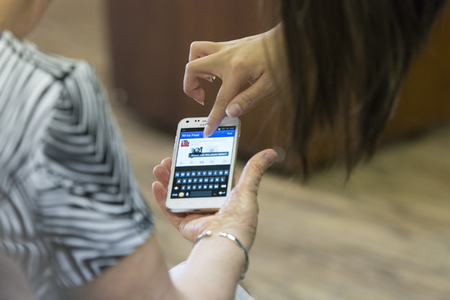 Alex Morgan, 16, right, volunteers by teaching Judy Hoffman, 73, how to share photos on social media during a smartphone usage class at Indigo Valley Church in Las Vegas on Friday, Aug. 5, 2016. J ...
