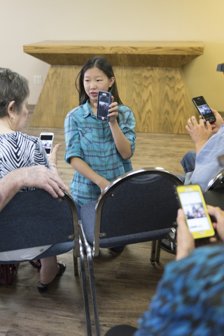 Alex Morgan, 16, center, volunteers by teaching a smartphone usage class at Indigo Valley Church in Las Vegas on Friday, Aug. 5, 2016. Jason Ogulnik/Las Vegas Review-Journal