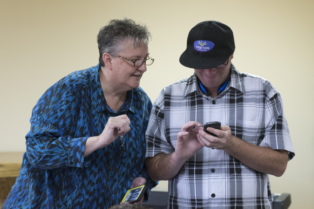Pastor Charlotte Morgan, left, and William Winstead, share smartphone tips during a smartphone usage class at Indigo Valley Church in Las Vegas on Friday, Aug. 5, 2016. Jason Ogulnik/Las Vegas Rev ...
