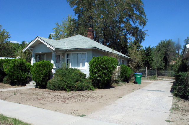 The garage no longer sits behind this house on East Ninth Street in Reno, pictured Thursday, Aug. 21, 2014, where 19-year-old Michelle Mitchell's body was found in 1976. Cathy Woods, who was convi ...