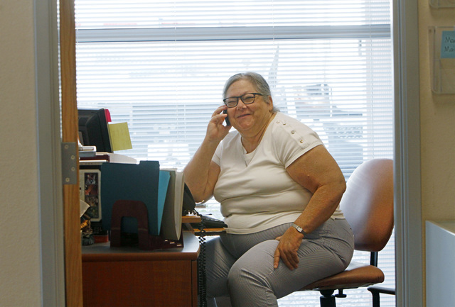Volunteer Mary Burns, 61, of Las Vegas talks on the phone at the office of Helping Hands of Vegas Valley in North Las Vegas, Thursday, Aug. 18, 2016.  Chitose Suzuki/Las Vegas Review-Journal