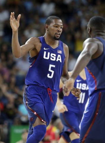 United States' Kevin Durant (5) celebrates a score against China during a men's basketball game at the 2016 Summer Olympics in Rio de Janeiro, Brazil, Saturday, Aug. 6, 2016. (Eric Gay/Associated  ...