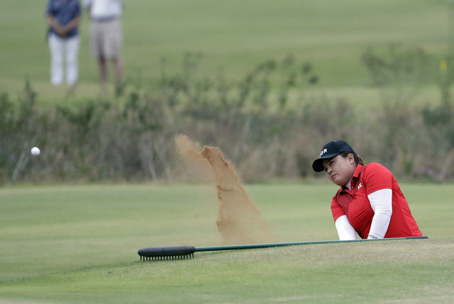 Inbee Park of South Korea, hits from a bunker on the 18th hole during the final round of the women's golf event at the 2016 Summer Olympics in Rio de Janeiro, Brazil, Saturday, Aug. 20, 2016.(AP P ...