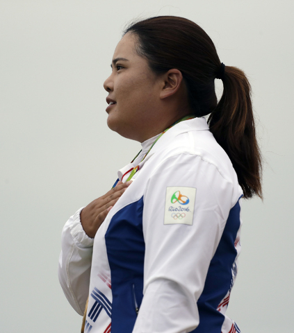 Inbee Park of South Korea, listens to her national anthem after winning the gold medal in the final round of the women's golf event at the 2016 Summer Olympics in Rio de Janeiro, Brazil, Saturday, ...