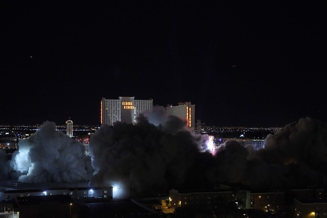 The Riviera's Monte Carlo Tower, right, is imploded along with the property's remaining structures early Tuesday August 16, 2016. (Sam Morris/Las Vegas News Bureau)