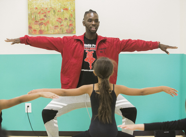 Former Cirque du Soleil dancer Tyrell Rolle demonstrates some moves for participants in  R.A.G.E. (Reaching Above Greater Expectations) during a summer session at his new North Las Vegas studio. J ...