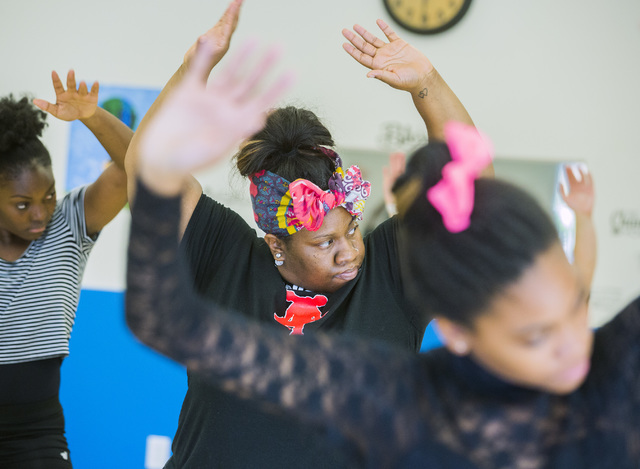 Aleisha Hall, center, participates in a contemporary dance class at Studio 305, the new home of former Cirque du Soleil dancer Tyler Rolle's R.A.G.E. (Reaching Above Greater Expectations) program  ...