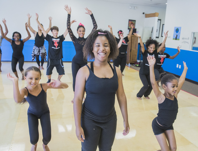 Chancey Wilson, 17, center, joins other participants at a weekday session of R.A.G.E. (Reaching Above Greater Expectations), a summer dance program founded by her brother, former Cirque du Soleil  ...