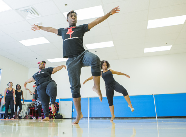 Dedrick Stewart, 21, center, performs contemporary dance moves at Studio 305 in North Las Vegas, home of R.A.G.E. (Reaching Above Greater Expectations), a program for at-risk kids founded by forme ...