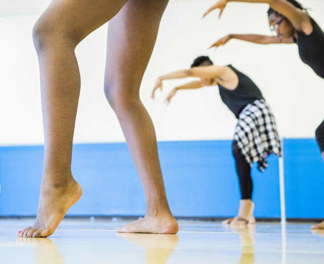 Re' Williams, left, Chauncey Newsom, 16, and Aniyah Brantley, 13, take part in a contemporary dance class, part of the R.A.G.E. (Reaching Above Greater Expectations) program created by former Cirq ...