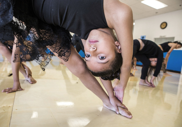 Elena Rodriguez, 7, stretches as part of a weekday session at R.A.G.E. (Reaching Above Greater Expectations), which offers all-day dance classes at Studio 305 in North Las Vegas. Jeff Scheid/Las V ...