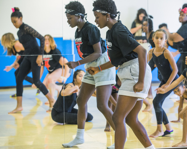 Dance teacher Ari Williams, center, leads students in contemporary dance during a recent weekday session at Studio 305 in North Las Vegas, the new home for R.A.G.E. (Reaching Above Greater Expecta ...