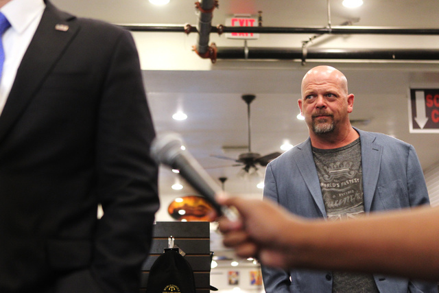Rick Harrison, co-owner of World Famous Gold & Silver Pawn Shop, listens to then-Republican presidential candidate U.S. Sen. Marco Rubio, R-Fla., during a press conference at the shop in Las V ...